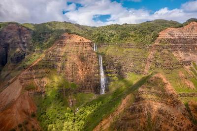 Wide angle view of the beautiful Waipo'o Falls in Waimea Canyon State Park, Kauai, Hawaii, shot from a helicopter.