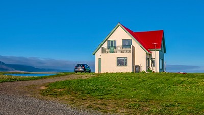 Street view of a picturesque Icelandic home in rural West Iceland, with vibrant color and copy space.