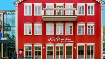 Reykjavik, Iceland - June 15, 2015. Street view of the picturesque Fjalakotturinn Restaurant, located in the Hotel Centrum.