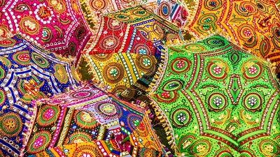 A colorful set of parasols with vibrant colors and intricate patterns.