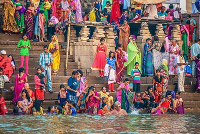 Hindu pilgrims bathing in the Ganges River from the ghats of Varanasi.