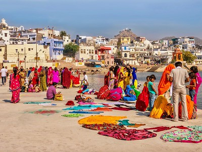 Indian Hindu religious pilgrims gathered beside Pushkar Lake.