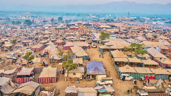 Aerial view of the horse trading section of the Pushkar Camel Fair waking up on a misty morning.