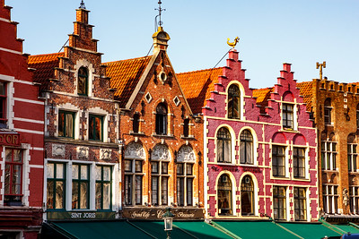 Colorful buildings form one wall of The Markt