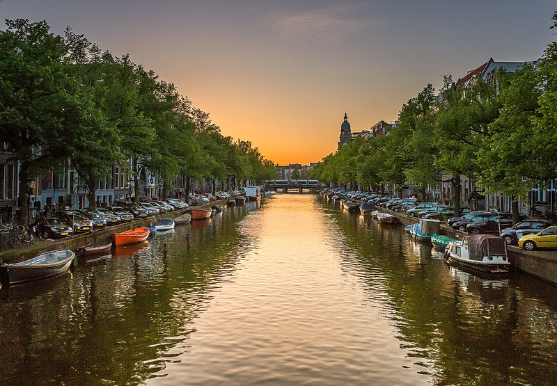 Setting sun on Amsterdam houseboats