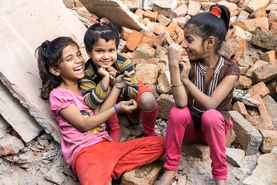 There was so much joy in many of the children I encountered in Bawana. Now and then I would witness a child in dispair but more often than not, the children, like these girls laughed and played and found much entertainment in watching us work.