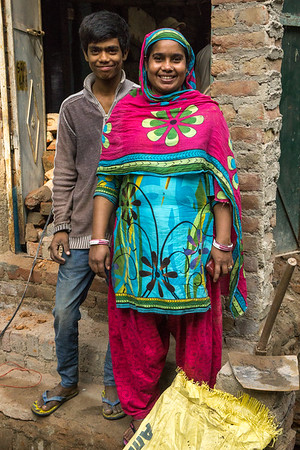 Munni and one of her sons near the build site of her home.