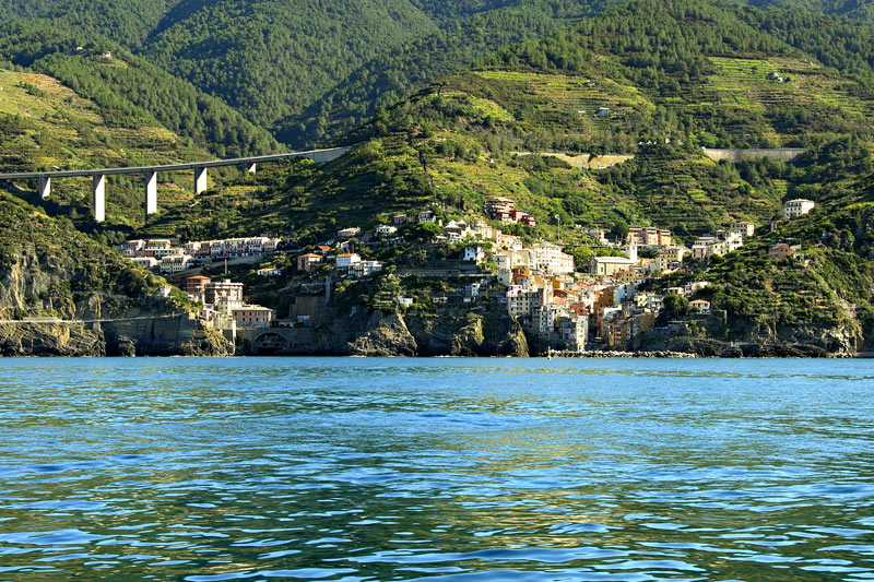 The next nine photos are of the village of Manarola taken from the boat as we left this lovely village. On the right side is the little port of Manarola where we boarded our boat.