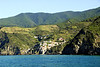 The village from further away. Manarola  is a small village, a fraction of the comune of Riomaggiore. It is the second smallest of the famous Cinque Terre villages frequented by tourists.