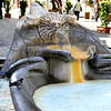 A closer view and detail of the Barcaccia Fountain.