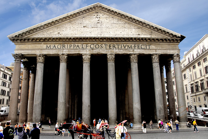 "Michelangelo said ""It was the work of angels, not men"".<br /> <br /> The name comes from two Greek words pan, ""everything"" and teon ""divine"". Originally, the Pantheon was a small temple dedicated to all Roman gods. Built between 27 and 25 B.C. by the consul Agrippa, Prefect of the Emperor Augustus, the present building is the result of subsequent, heavy restructuring.<br /> <br /> Domitian, in 80 A.D., rebuilt it after a fire; thirty years later it was hit by lightening and caught fire again. It was then rebuilt in its present shape by the Emperor Hadrian; under his reign, Rome reached its maximum splendour, and the present structure is probably the fruit of his eclectic genius and exotic tastes.<br /> <br /> This is the front elevation of the Pantheon that has the portico in front. The building faces the Piazza Della Rotonda.<br /> <br /> Some information shown above was taken from  <a href=""http://www.italyguides/"">http://www.italyguides/</a>"
