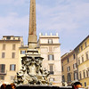 "This is the obelisk and fountain at Piazza della Rotonda in front of the Pantheon, the heart of the Centro Storico. It is a popular meeting place for all ages, particularly in the summer months. The pleasant cafes, bars and tea rooms which encircle the square and its fountain, create a lively atmosphere late into the night. <br /> <br /> The obelisk was found in the Iseo Campense and was placed here in 1711. It was decorated with dolphins and coats of arms of Pope Clement XI.<br /> <br /> Information taken from   <a href=""http://www.planetware.com/rome/"">http://www.planetware.com/rome/</a>"