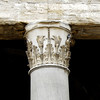 A closer look at the capital of the 16 monolithic Corinthian columns topped by a pediment.