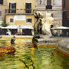 A partial view of the reflecting pool around the fountain and the cafe's and tea shops that sorround the Piazza Della Rotonda.