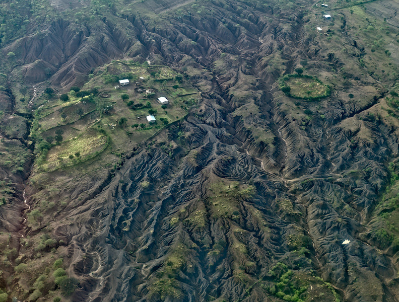 © Robert Will 2013<br /> <br /> Our flight passes over the Great Rift Valley. <br /> <br /> From this height, it is easy to see how plate tectonics have ripped apart the landscape.