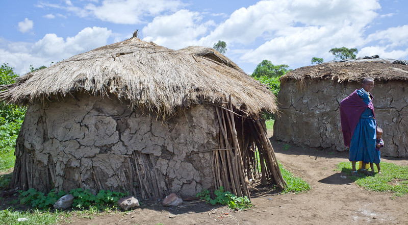 Each of the Chief's wives lives in her own hut made from sticks, mud and dung.