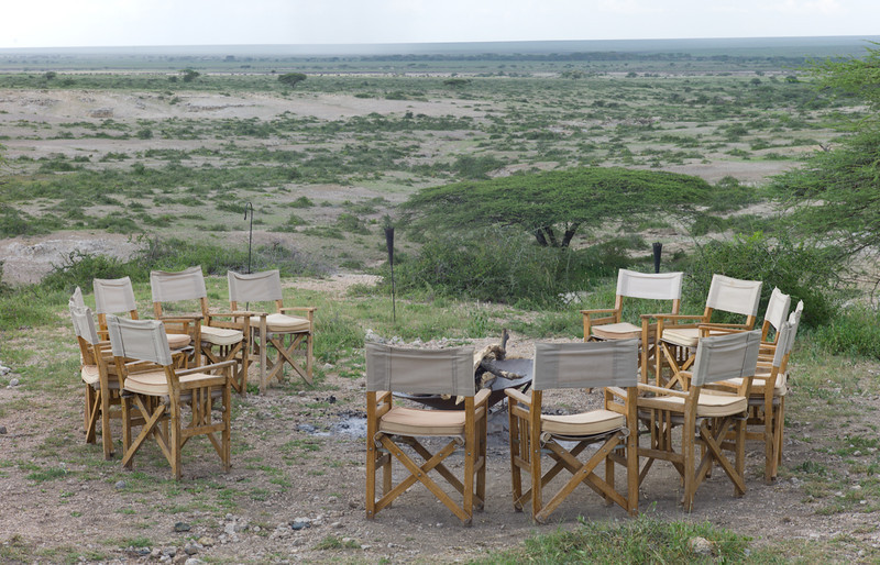 In the evenings, we would sit around the fire and have a couple of cold ones before dinner. <br /> <br /> On our first night, giraffes were striding across the landscape below. <br /> <br /> It was a surreal experience.