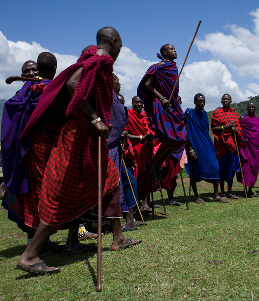Young Masai men compete to see who can jump the highest. The tribe sings while the jumping competition takes place.