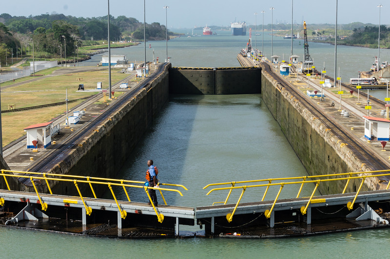 View of Northernmost Gatun Lock<br /> This is a view of the northernmost lock chamber on the Panama Canal.  Ahead is the Caribbean Sea (Atlantic Ocean).  As soon as the water levels equalize, our ship will move north into this last lock chamber to be lowered to the level of the Atlantic Ocean.  In the distance, the blue ship went through the locks ahead of us and is now streaming its cargo of cars to the Eastern United States or Europe.