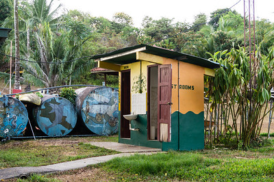 Park Rest Rooms Colorful rest rooms at the A Black Vulture wandering around the park headquarters, Isla Coiba National Park, Panama.
