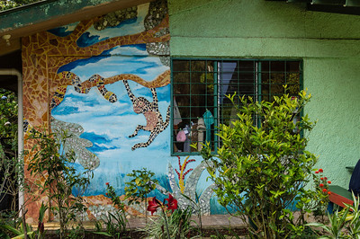 Artist Store Mural There is a local artist store in Monteverde where we stopped for souvenirs.  This is part of the tial mural on the outside of the store.