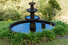 Fountain at Fonda Vela<br /> This is a fountain on the grounds of the hotel Fonda Vela, in Monteverde, where we spend two nights.  The water is reflecting the early morning sky.