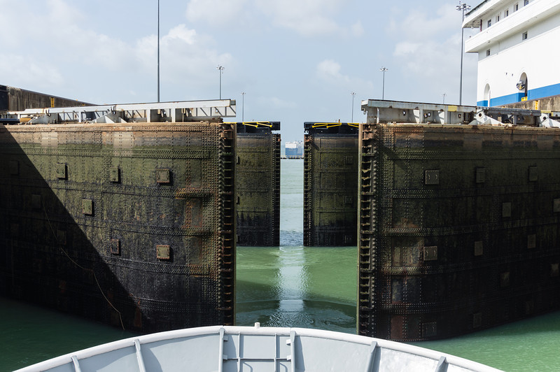 Gatun Locks Opening<br /> Now that the water level has dropped in this chamber o fthe Gatun Locks, the doors are opening to let out ship move north into the next lock Chamber.  (Panama Canal.)