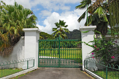 Gate to the new parliament building   (Mar 19, 2006, 12:52pm)  The taxi made one stop, at the Fort Young Hotel, on its way to the Cocoa Cottages.  While we were stopped, I took this picture of the entrance to the grounds of the new parliament building, in Roseau.