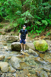 Dave at Breakfast River   (Mar 21, 2006, 09:11am)  hiking time: 65 mins   Here is Dave standing on a rock in the breakfast river, looking towards the steep climb ahead.