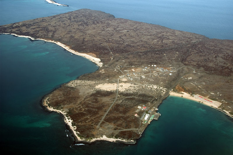<b>Island of Balta, north of Santa Cruz</b>   (Dec 08, 2005, 04:55pm)  <p align=left>The Galapagos main airport is on the island of Balta, which is just north of Santa Cruz.  The airport was built by the US military during World War II, but it now serves only civilian duties.</p>  <p align=left>Here is a picture of the northern part of Balta (North is to the upper-left) as we approached for a landing.  You can see a few buildings on the coast, but there really is very little on the island except for the airport.</p>