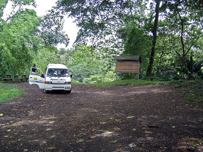 <b>Start of the La Soufriere hike</b>   (Jul 17, 2004, 10:38am)  <p align=left>And here we have the trailhead.  The car (which you see pictured), took us up to the 1000 foot level on the volcano's slope, but the rest was up (sic) to us.  The crater's lip is at 4,049 feet; only 3,000 up from this point.</p>