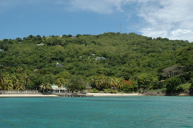 <b>The shore of Bequia's Lower Bay</b>   (Jul 18, 2004, 01:06pm)  <p align=left>In a fit of naming frenzy, a couple of the sections of Admiralty Bay in Bequia are given their own name.  The northwest part of Admiralty Bay is called Point Bay, and the southwest part of Admiralty Bay is also known as Lower Bay.  There are a couple of hotels and guest houses along the eastern shore of Admiralty Bay, south of Port Elizabeth.  This is one of the hotels (I do not know its name).</p>  <p align=left></p>