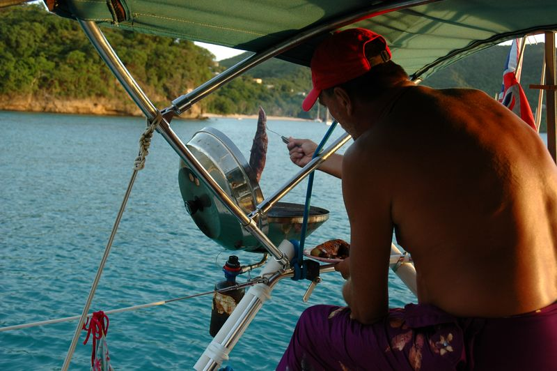 <b>Using the barbeque on the sailboat</b>   (Jul 18, 2004, 06:15pm)  <p align=left>Dinner that night was barbequed pork.  Jeremy cooked the meat on this small barbeque grill attached to the side of the sailboat.</p>  <p align=left></p>