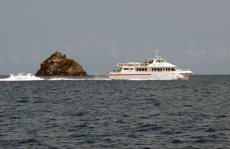 <b>The Osprey Shuttle passes by</b>   (Jul 21, 2004, 10:10am)  <p align=left>As we left Tyrell Bay, on our way to Mayreau, I took this picture of the Osprey Shuttle as it passed by Mabouya Island, just north of Carriacou.  The Osprey Shuttle runs between Grenada and Carriacou's Hillborough jetty (on the north shore), making the run in only 70 minutes (which would be more impressive if I know how far apart the islands were).</p>  <p align=left></p>