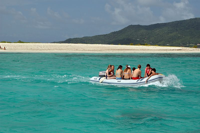 <b>An overloaded dingy leaving Sandy Island</b>   (Jul 20, 2004, 03:13pm)  <p align=left>Here is another example of a group of people who visited the beach on Sandy Island.  As you can see in this picture, the dingies can get awfully crowded.</p>  <p align=left></p>