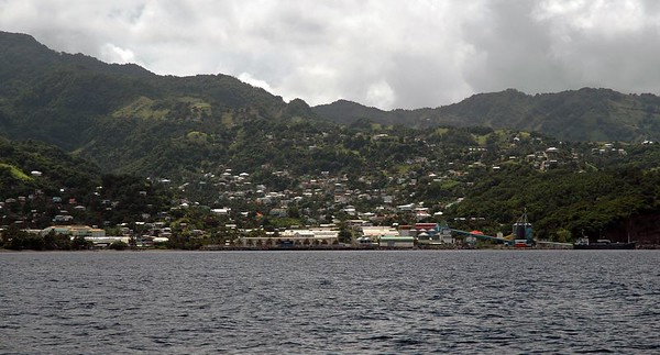 Industrial coast of St. Vincent   (Jul 18, 2004, 10:33am)  We left Petit Byahaut around 10am and sailed south for Bequia.  While we were sailing past the coast of St. Vincent, I took this picture. This is Camden Park Bay, the industrial heartland of St. Vincent.