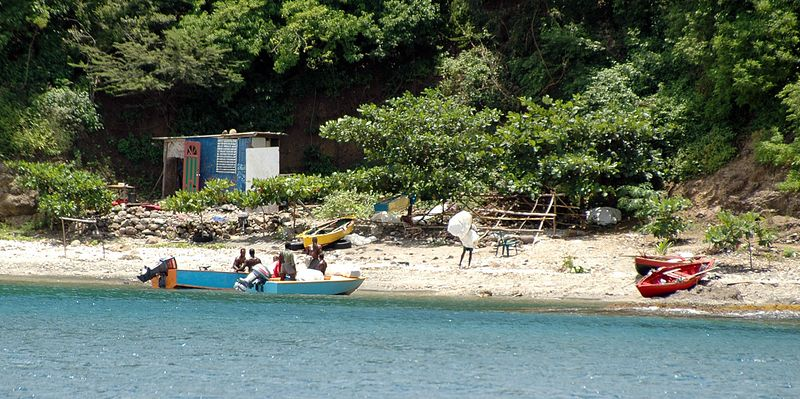 <b>Local fisherman on northwest point of Bequia</b>   (Jul 18, 2004, 12:10pm)  <p align=left>We were heading for Admiralty Bay, on the west side of Bequia, sailing from the north.  This picture shows the shore of Rocky Bay, a small bay on the outside point of land that makes up the northernmost part of Admiralty Bay.  The picture shows what looks like local fisherman in a small encampment on the shore of Bequia.</p>  <p align=left></p>