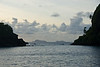 View from Young Island (Dec 14, 2008, 06:39am)<br /> <br /> In the early dawn, this is a view from behind Young Island, looking southeast.  The islands of Bettowia and Baliceaux can be seen in the distance.  Young Island is on the left, and Fort Rock is on the right.