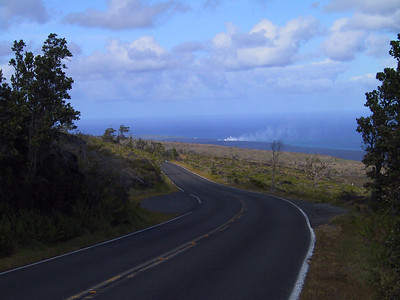 Steam from active lava flow entering ocean seen in distance   (Jul 17, 2001, 04:24pm)