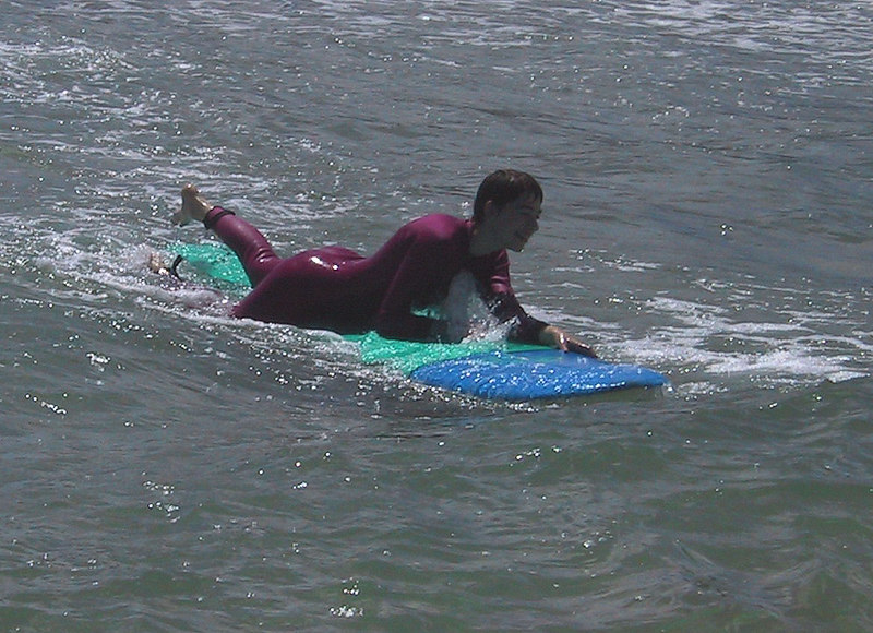 <b>Beth has a good time using the surfboard</b>   (Jul 25, 2001, 10:54am)