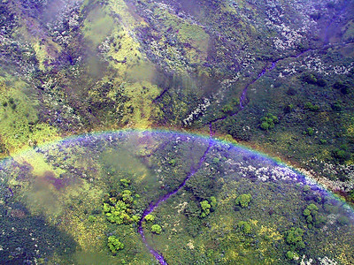 Rainbow seen from helicopter thru raindrops on camera lens   (Jul 26, 2001, 01:07pm)