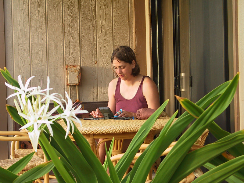 <b>Daphne outside our Pono Kai condo writing in hew journal</b>   (Jul 26, 2001, 06:34am)
