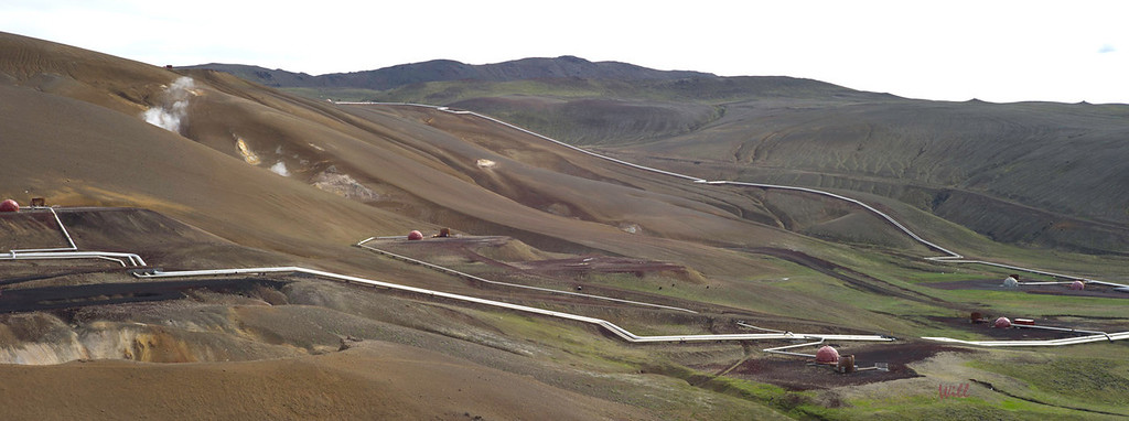 The Krafla area is home to the massive Krafla Geothermal Power Station. Krafla has proved to be an excellent site for geothermal power due to the close proximity of the magma to the surface (2-4 km).<br /> <br /> This photo shows geothermal pipes in the hills near Krafla.