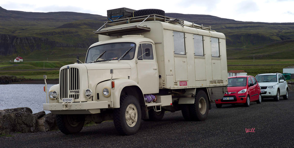 © Robert Will 2013<br /> <br /> This massive 4 wheel drive truck is an example of the custom vehicles that are built to navigate the rugged interior of Iceland.<br /> <br /> Our rental car is the little red job that is sniffing the Super 4x4's tail.