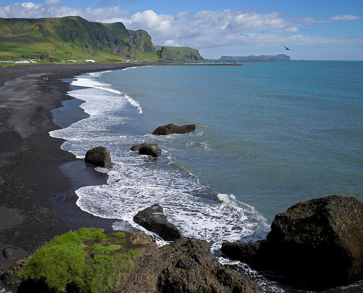 Vik is the southernmost point on the Iceland Ring Highway (Highway 1). This photo shows Vik's famous black volcanic sand beach.