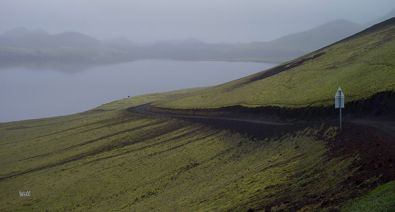 The bus winds its way to Landmannalaugar past this pretty (but misty) little lake.