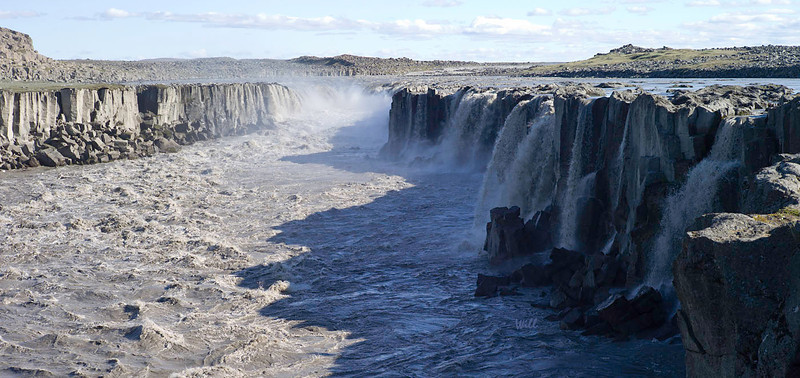 Selfoss. <br /> <br /> Scientists believe that 8-10,000 years ago, a single catastrophic jökulhlaup carved this gorge through which the Jökulsá á Fjöllum river flows. The gorge runs from Vatnajökull all the way to the Greenland Sea.<br /> <br /> Selfoss is a couple of hundred meters upstream from Dettifoss.