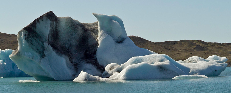 To me, this iceberg looks exactly like a young bird hatching from an egg.
