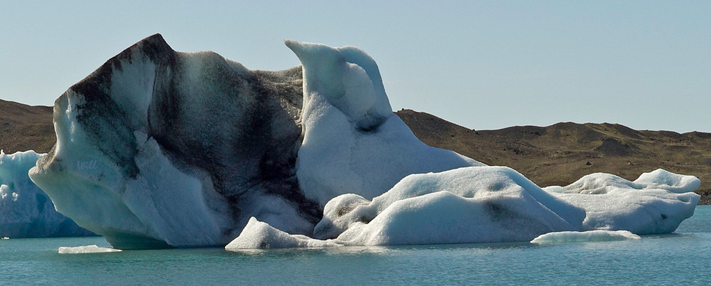 © Robert Will 2013<br /> <br /> To me, this iceberg looks exactly like a young bird hatching from an egg.