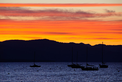 Sunset over KLake Tahoe with boats.